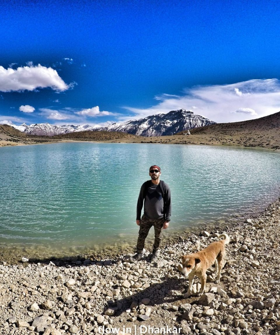 Backpacker and a dog at Dhankar lake