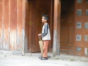 kid-with-his-home-made-cricket-bat